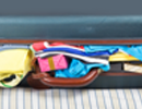 stock image of overpacked suitcase